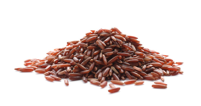 Pile of brown rice on white background