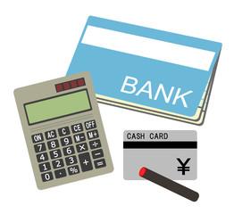電卓と通帳とカード
