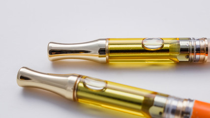 Full Gram THC/CBD Concentrated Oil In Cartridges Closeup On White