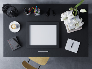 mock up design template to showcase artwork of empty poster in modern workspace in horizontal frame resting on a black polished table in straight top view