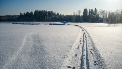 Ski trail on a snow covered road