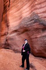 Woman hiker inside a slot antelope canyon in Page Arizona