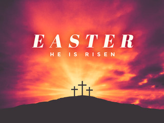 Easter He Is Risen Text with Three Christian Crosses on Hill of Calvary with Colorful Clouds in Sky and Ray of Light
