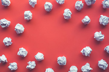 Creativity inspiration,ideas concepts with paper crumpled ball on red color