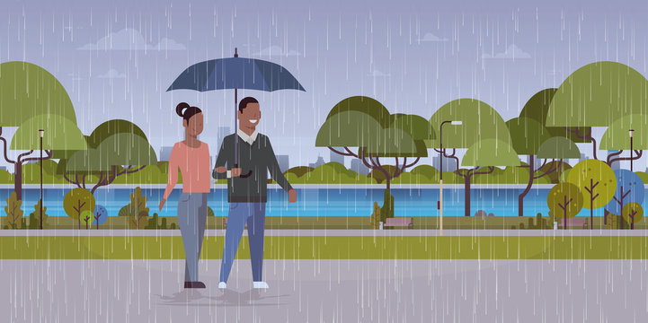 lovers couple under umbrella african american man woman romantic walking in rain city urban park landscape background full length characters flat horizontal