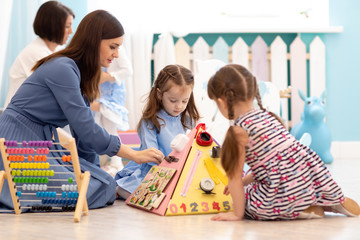Kids play with educational toys in nursery
