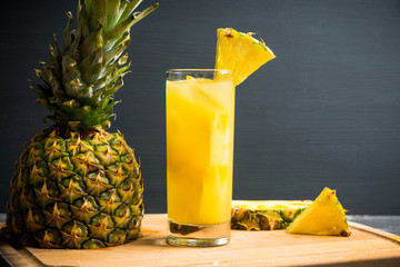 Fresh pineapple beverage on rustic background. Selective focus. Shallow depth of field.