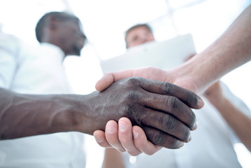 close up.business handshake over blurry background