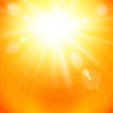 Dramatic golden sunburst in a fiery orange sky.
