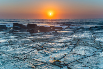 Sunrise Seascape and Tesselated Rock Ledge
