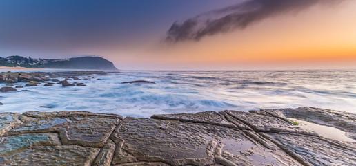 Sunrise Seascape Panorama and Tesselated Rock Ledge