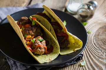 Tacos with meatballs and sauce