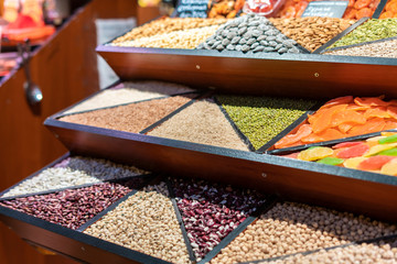 Printed kitchen splashbacks Zanzibar counter with rows of different grains in the market store f