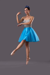 View from side of ballerina dancing on isolated background