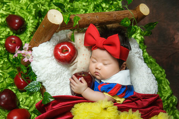The cute baby is sleeping and looks very comfortable.  Fotomurales