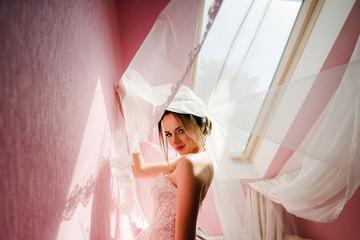 Bride posing in a white wedding dress