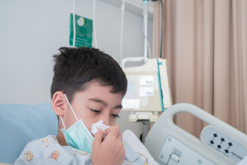 Little boy get sick from influenza need to be admitted to hospital with saline intravenous (iv)  in-line hand pressure