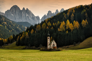 St. Johann (San Giovanni in Italian) Chapel in Val di Funes with the Dolomites Odle group on background. Northern Italy. Wall mural