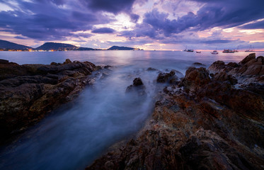Long exposure image of Dramatic sky seascape with rock in sunset scenery, Beautiful Landscape and light of nature in evening with beautiful colors Clouds and sky