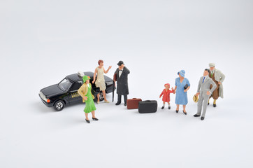 small human figure and a japan taxi