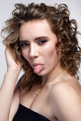 Girl is showing tongue