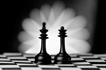 King and Queen, chess pieces on the Board. Chess is a popular ancient Board logic antagonistic game with special black and white pieces, on a cell Board for two intelligent opponents.
