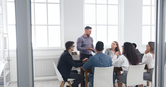 Group of business people having brainstorm meeting