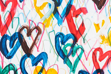 background of colorful painted hearts on white background