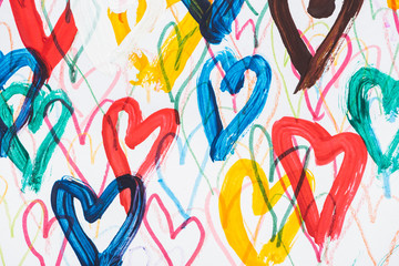 artistic background of colorful painted hearts on white background