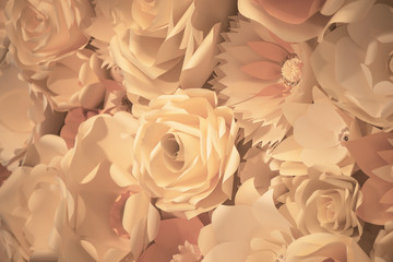 Color filter effect in sepia of a 3D paper flower wall, decor idea or backdrop for weddings, baby shower, birthday or tea parties. Romantic three-dimensional monochrome decoration for background ideas