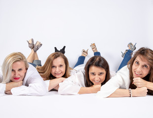 Photographs of a group of friends lying on the floor