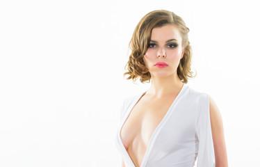 Girl confident model seductive posing on white background. Attractive appearance concept. Sexy seductive dress. Woman elegant lady retro hairstyle and makeup wear white dress with seductive decollete