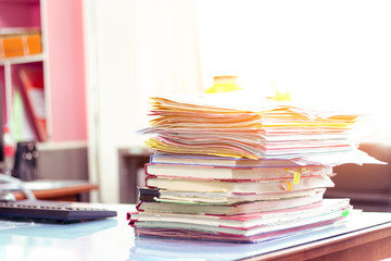 Wall Mural - Stack of documents placed on a business desk in a business office.