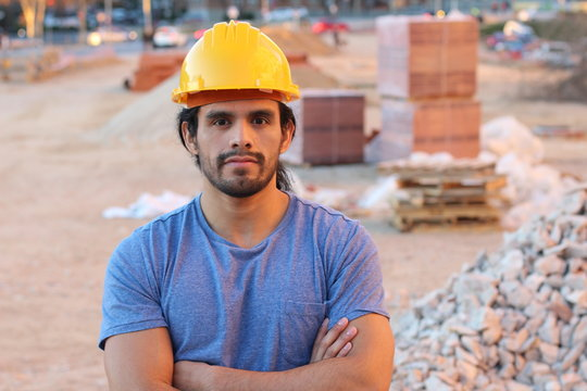 Muscular tough construction worker with arms crossed