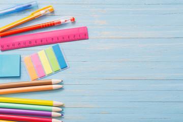 school supplies on  blue wooden background