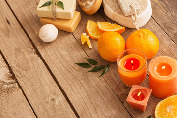 spa concept with orange fruits on old wooden background