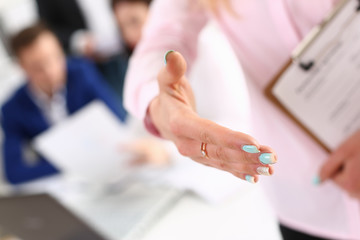 businesswoman offer hand to shake hello in office
