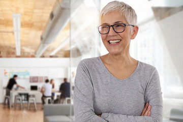 Happy smiling business woman in an office. Teamwork , success concept Wall mural