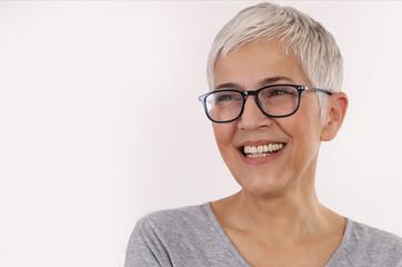 Happy Smiling Senior Woman wering glasses on white background.