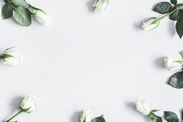 Flowers composition. White rose flowers on pastel gray background. Flat lay, top view, copy space