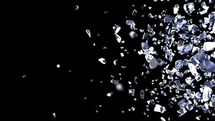 Particles and fragments of glass or crystals on a black background