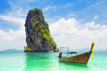 Thai traditional longtail boat and beautiful sand beach