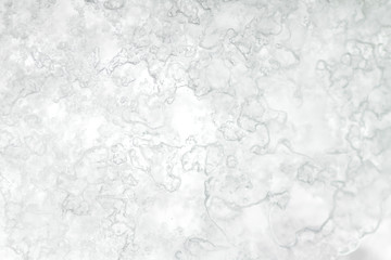 Frosted snow on a window, abstract background or texture