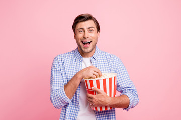 Close up photo of beautiful amazing brunet he him his handsome holding pop corn laughing on favorite tv show wearing specs casual checkered plaid shirt outfit isolated on rose background