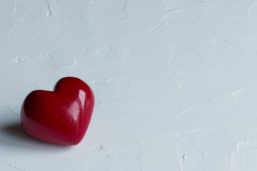 red heart on rustic white background