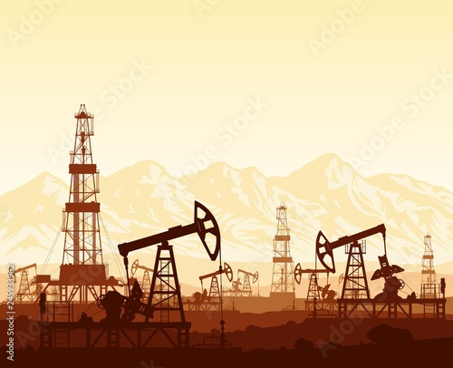 Oil pumps and drilling rigs silhouettes at large oilfield on