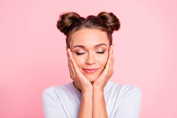 Close-up portrait of her she nice cute lovely attractive fascinating lovable winsome calm girl with buns touching cheeks closed eyes isolated over pink pastel background Wall mural