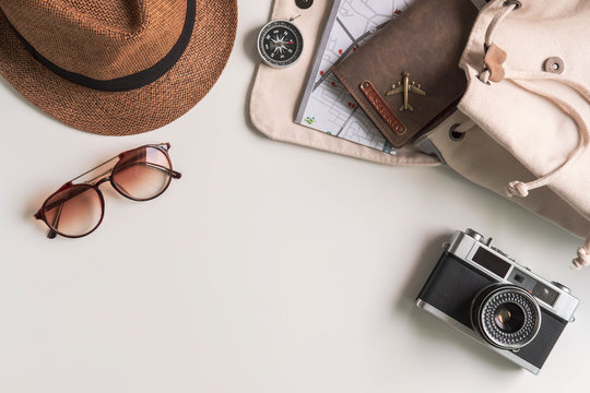 Retro camera with travel accessories and items on white background with copy space, Travel concept