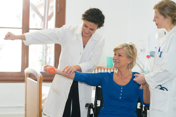 woman doing arm rehabilitation therapy movement