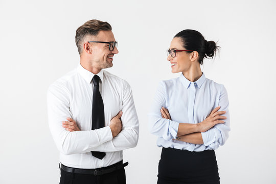 Young happy business colleagues couple isolated over white wall background.